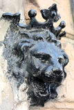 Lion head decoration. Crowned lion head decoration of the black color at the wall of an old  building in Odessa (Ukraine Stock Images