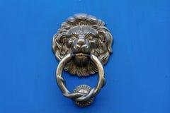 Lion head door knocker on a blue door Stock Photography