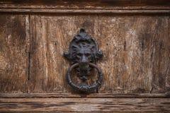Lion head door knocker. On old wooden door royalty free stock photos