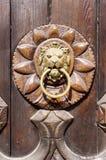 Lion head, Door knocker on wooden door Stock Photo