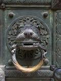 Lion head doorknocker. The bronze door of St Benno church in Munich, Germany, with its lion head doorknocker Stock Photography
