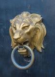Lion head doorknocker on a metal door Royalty Free Stock Photography