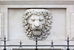 Lion Head High-Relief. Roaring lion head high-relief on the facade of a palace Royalty Free Stock Photography