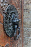 Lion Head Knocker, Ancient bronze handles on old oak door Royalty Free Stock Photo