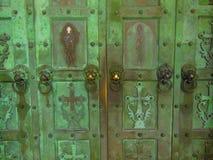 Lion head knockers on old door Stock Image