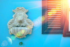 Lion head model is art ,Carve for cement on blue wall background. Stock Photo