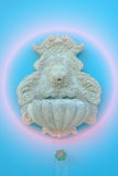 Lion head model is art ,Carve for cement on blue wall background Royalty Free Stock Photography