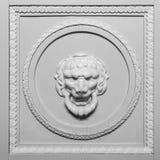 Lion head relief on the facade Stock Photos