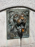 Lion head sculpture with water flow Stock Photography