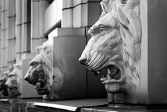 Lion head sculptures on building Stock Photo