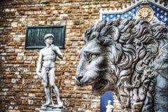 Lion head statue in Lanzi della Loggia with Michelangelo's David Stock Photo
