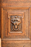 Lion head wood carving on wooden door Stock Photography