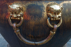 Lion heads on a water vat (Forbidden City) Stock Photo
