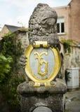 Lion holding Crest Royalty Free Stock Image