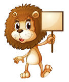 A lion holding an empty sign board Stock Image