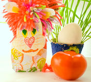 Lion homemade cardboard egg and greens Stock Images