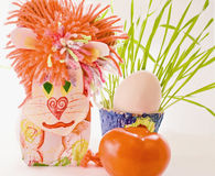 Lion homemade cardboard egg and greens Royalty Free Stock Photos