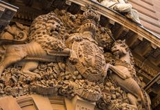 Lion and horse high sculptural relief on a historic building. A Lion and horse high sculptural relief on a historic building royalty free stock image