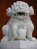 Lion at Jing an Temple. With coins in its mouth, Shanghai, China Stock Photography