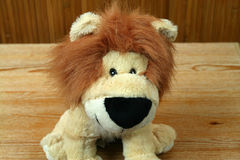 Lion king. Plush lion mascot. Cheerful animals king Stock Photos