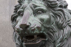 Lion on King Karl XIII Statue by Fogelberg, King's Garden - Ku Royalty Free Stock Photos