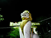 Lion king. A statue of holy lion in front of the temple in Thailand Royalty Free Stock Photo