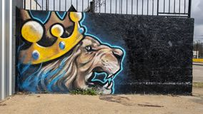 Lion King Wall art mural in Deep Ellum, Dallas, Texas. Pictured is an unnamed and unsigned colorful wall art mural in Deep Ellum featuring a lion wearing a king` Royalty Free Stock Images