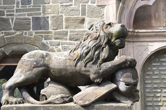 Stone Lion with knight armour Stock Images