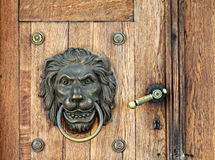 Free Lion Knocker And Handle On Wooden Door Royalty Free Stock Photo - 20207265