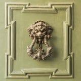 Lion knocker. Doors with door knocker in the shape of lion head Stock Photography
