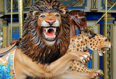 Lion and Leopard on carousel ride Stock Photography