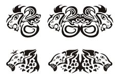 Lion and leopard heads in tribal style. Symbols of the predator heads. Black on the white stock images