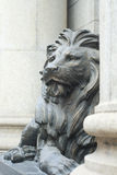 A lion lies between two Roman columns Royalty Free Stock Images