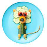 Lion made of vegetables on blue plate Royalty Free Stock Image