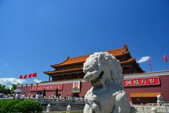 Lion and main building in forbidden city in Beijing Stock Photos
