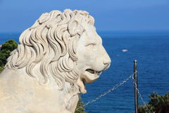 Lion marble sculpture. Park and the mountains near the Vorontsov Palace, Crimea. Stock Image