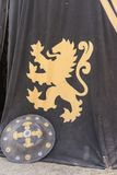 Lion, medieval tent of different colors with coats of arms and b Royalty Free Stock Images