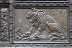 Lion on a metallic door Stock Image