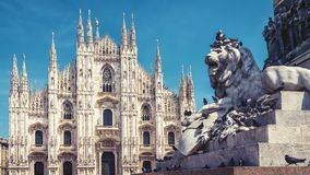 Lion and Milan Cathedral in Milan, Italy. Sculpture of a lion and Milan Cathedral on the Piazza del Duomo in Milan, Italy. The Milan Cathedral Duomo di Milano in royalty free stock image
