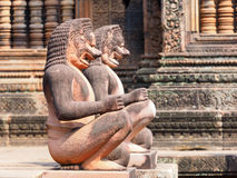 Lion and Monkey Gardians Carvings at Banteay Srei Red Sandstone Temple Stock Images