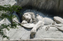 The Lion Monument or the Lion of Lucerne, in Lucerne, Switzerland. LUCERNE, SWITZERLAND - JUNE 12, 2013: The Lion Monument or the Lion of Lucerne, in Lucerne royalty free stock photo