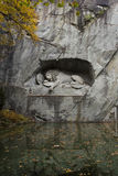 Lion monument. Wounded Lion - the monument to the Swiss Guards Stock Photos
