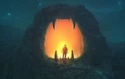 Lion mouth cave. A man walks into a cave in the shape of a lion`s mouth Stock Photo
