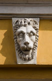 Lion muzzle. Sculpture on the wall Royalty Free Stock Photography