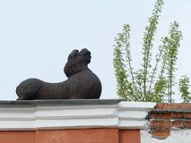 A lion over an arch leading to the courtyard of the merchants` house Morozov on the Socialist Avenue in Barnaul. BARNAUL, RUSSIA - MAY 10, 2017:A lion over an Royalty Free Stock Image