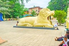 The lion in Peradeniya temple. PERADENIYA, SRI LANKA - NOVEMBER 28, 2016: The lion shaped building in Gatambe Sri Rajopawanaramaya Temple, on November 28 in Royalty Free Stock Photos