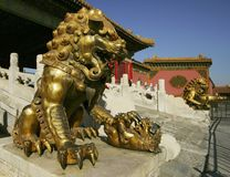 Lion playing a baby - a sculpture of palace gugun. Lion playing a beby - the sculpture to be in palace gugun. it is palace of the chinese emperor it to be in the Royalty Free Stock Photo