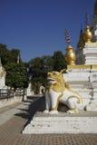 Lion protecting stupas of Maha Aung Mye Bonzan Monastery (Inwa, Myanmar) Royalty Free Stock Images