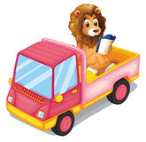 A lion reading a book at the back of a truck Royalty Free Stock Images