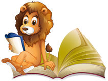 Lion reading storybook alone Royalty Free Stock Image